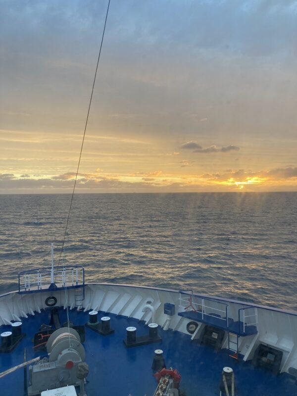 Photo Of A Sunrise In A Boat