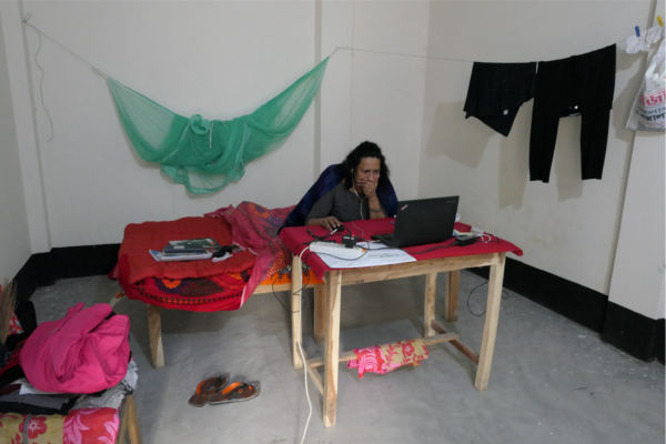 Photo of A Person Sitting On A Bed In Front Of A Laptop