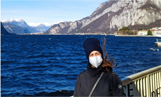 Photo of Denise in front of a lake, Italy