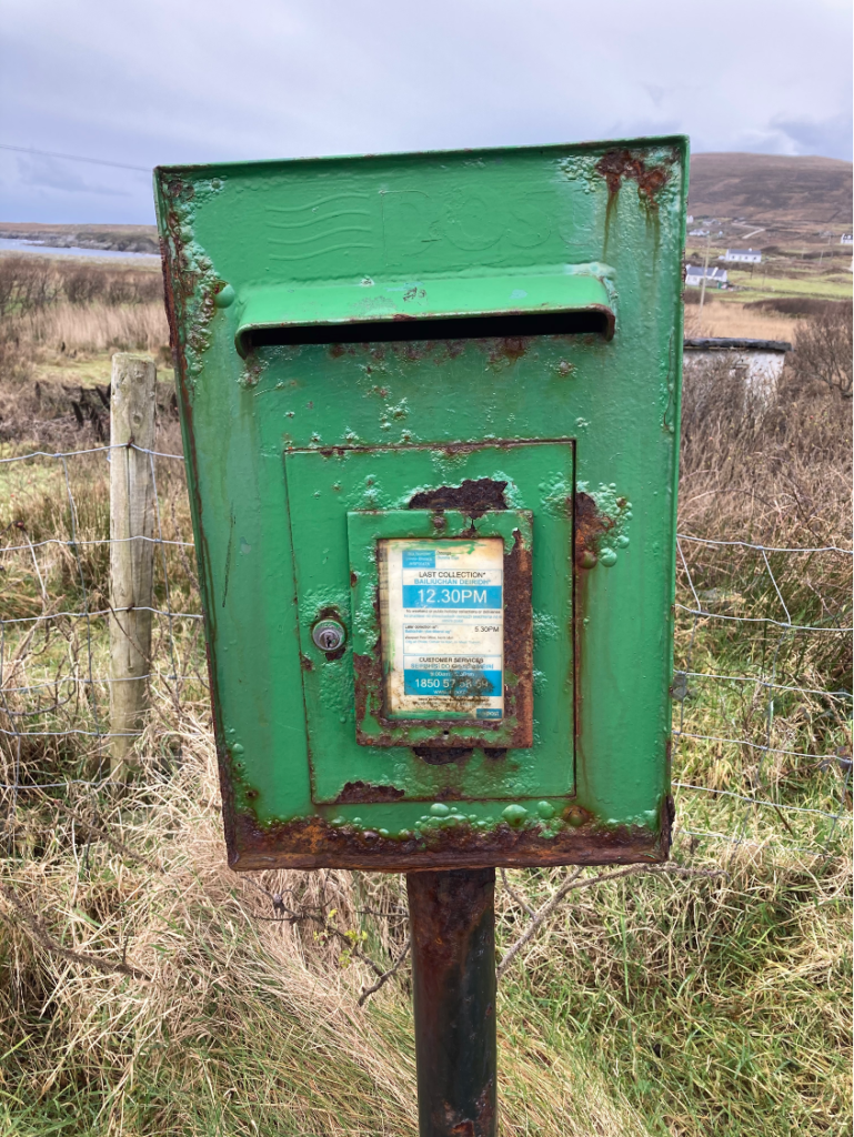 Photo of a rusty postbox in Ireland