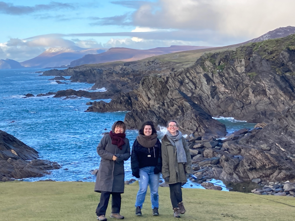 Photo of 3 people standing in front of the sea in Ireland