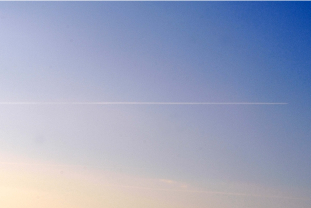 Photo of a plane high in the sky