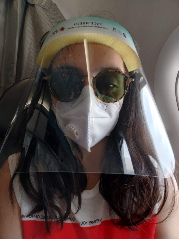 Photo of Vidushi wearing PPE for travelling