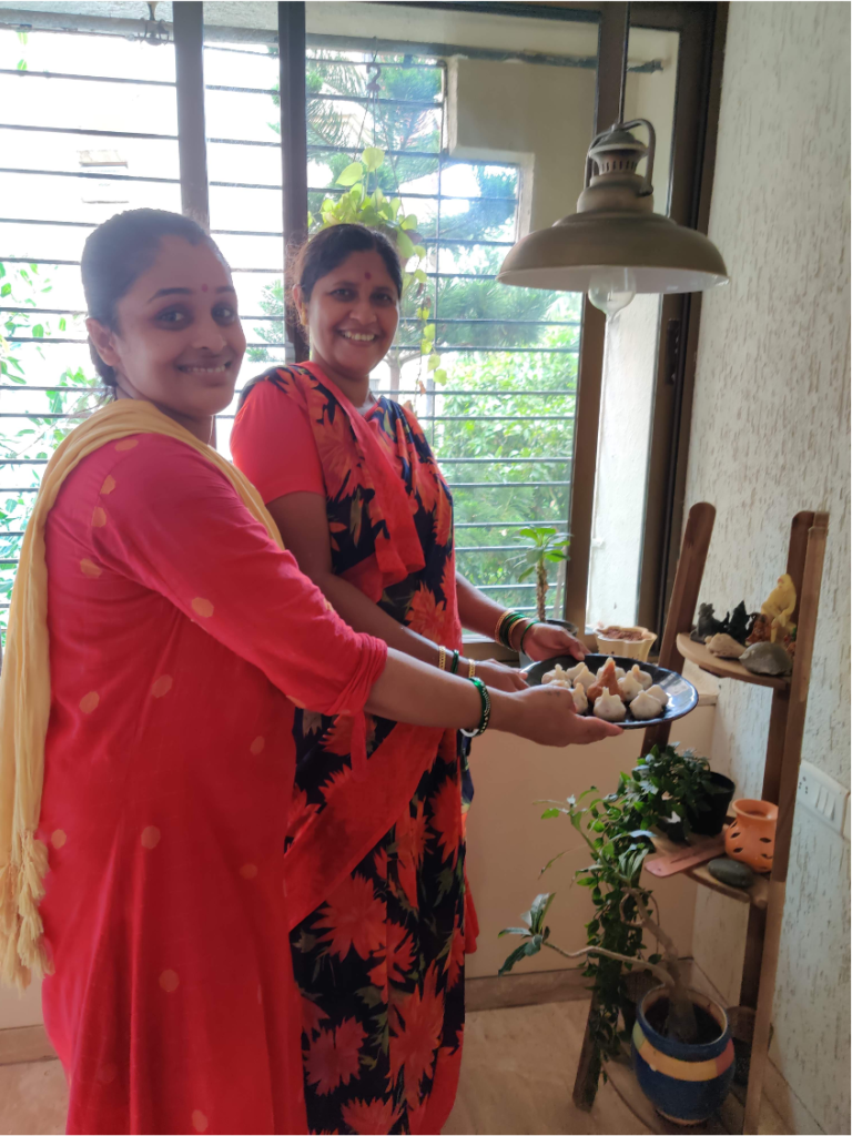Photo of 2 women offering food to Ganesh in India