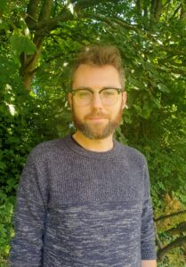 Profile Photo of Cathal Burke O'Leary in front of a tree
